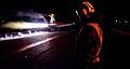 Defense.gov News Photo 111203-N-OY799-381 - A U.S. Navy sailor observes as an aircraft launches during night flight operations on the flight deck of the aircraft carrier USS John C. Stennis CVN.jpg