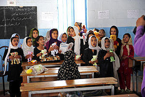 Farah, Afghanistan - Afghan girls sing songs to U.S. service members during a visit to the orphanage in Farah City June 19, 2012.
