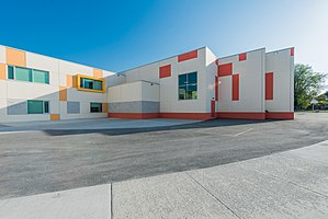Tilt up - The school's architectural design highlights the flexibility offered by tilt-up concrete construction. The building's tilt-up panels include brick veneer and concrete finishes that incorporate recessed images of children's artwork. Public School, Ottawa, ON