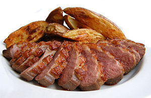 Red meat - Duck, with potatoes, showing the red color of the meat