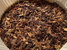 Ready rubbed pipe tobacco inside a round 100g tin