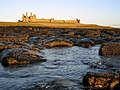 Dunstanburgh Castle at dawn - geograph.org.uk - 1133647.jpg