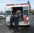 EMTs loading a patient.jpg