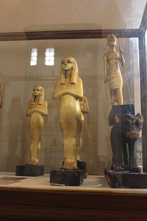 Neferneferuaten - To the right, mounted in its original position on the back of a leopard, is the statuette of a Pharaoh, with distinctly female attributes, restored in the Tomb of Tutankhamun, Egyptian Museum.