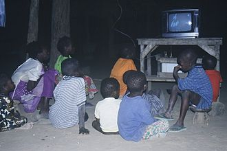 Telecommunications in Mali - Children watch television in a village in rural Mali.