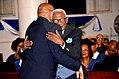 Eredoctoraat dr Eugène (Oom Sjenie) Gessel (82), met president Desi Bouterse.jpg