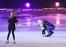 Evgeni Plushenko and Yana Rudkovskaya with son (Snow King show).jpg