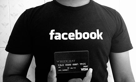 "A Facebook ""White Hat"" debit card, given to researchers who report security bugs. Facebook t-shirt with whitehat debit card for Hackers.jpg"