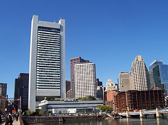 Federal Reserve Bank of Boston - The Federal Reserve building in Boston (tall white building on left, plus white lowrise in front of tower), and other buildings as seen from the south side of the Fort Point Channel. The Summer Street bridge is at the far left, and the Congress Street bridge on the right.