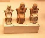 Female figurines sitting on thrones.jpg