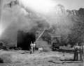 Fire prevention training; demonstration for students of Springdale school. Burning of old Justet home adjacent to Springdale (952b50885d434689998e9b825dfda5a5).tif