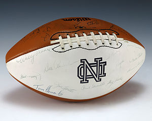 1974 Notre Dame Fighting Irish football team - A football signed by the 1974 Notre Dame Fighting Irish football team, including Ken MacAfee, Ara Parseghian, and Tom Clements.