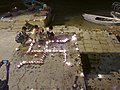 Formation of swastik with diyas on the eve of Diwali on Ghats of Varanasi , India.jpg