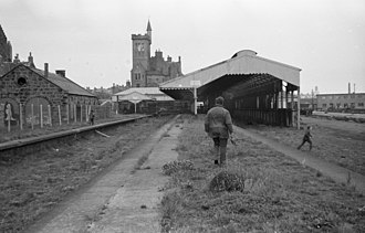 Formartine and Buchan Railway - Looking along a platform at Fraserburgh towards the remains of the station buildings. The former two road locomotive shed is on the left.