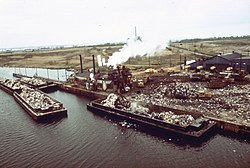 Garbage scows bring solid waste to Plant #2 at Fresh Kills Landfill, 1973.