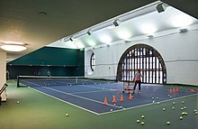 Tennis players using the terminal's court