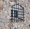 Gallerförsett fönster på Husby Sjuhundra kyrka.jpg