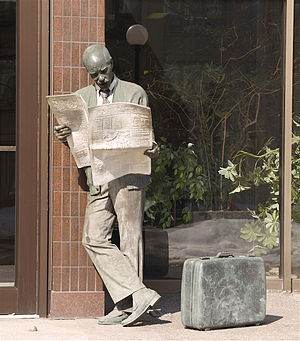 Montreal Gazette - A statue in Westmount of man reading The Gazette.