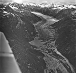 Gilkey Glacier, disarticulated terminus of valley glacier with glacial remnents and hanging glaciers on the mountainside, August (GLACIERS 6336).jpg