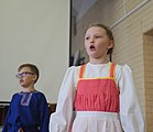 Girl singing at a concert at school Russia 2021.jpg