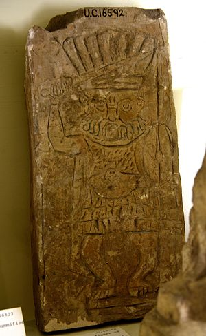 Bes - God Bes as a Roman soldier. Sword in right hand and spear and shield in left hand. Limestone slab, in relief. Roman Period. From Egypt. The Petrie Museum of Egyptian Archaeology, London