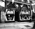 Goodyear Raincoat Co storefront at 614 2nd Ave decorated for the Golden Potlatch celebration, Seattle (CURTIS 1226).jpeg