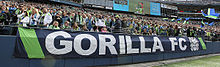 "Banner in front of the crowd read ""Gorilla FC""."