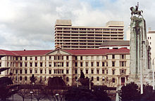 The Old Government Buildings, with the cenotaph in the foreground and NZ Post headquarters behind.