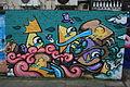Graffiti in Shoreditch, London - Artista (13820982434).jpg