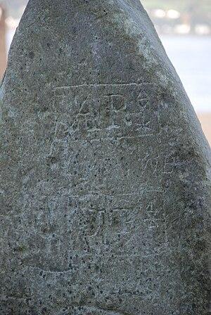 Granny Kempock Stone - Granny Kempock Stone - detail of graffiti showing possible mason's marks