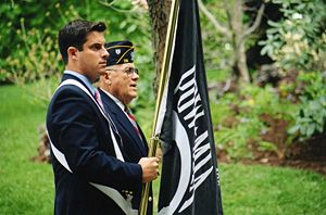Greg Ball (politician) - Ball participates in the 2007 Pawling Veterans Day parade carrying the flag of the POW-MIA.