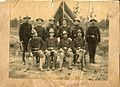 Group photograph of officers in uniform with a U.S. Volunteers unit (believed to be the First North Carolina Regiment), posing outside of a tent in the unit's military camp in an unidentified location (28259903644).jpg