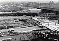 HUA-169143-Gezicht op de in aanbouw zijnde Spinozaweg en het nieuwe N.S.-station Rotterdam Lombardijen te Rotterdam, met op de achtergrond het goederenemplacement Rotterdam IJsselmonde.jpg