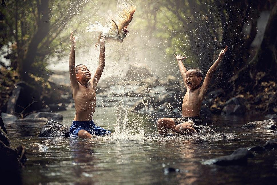Happy children splashing water