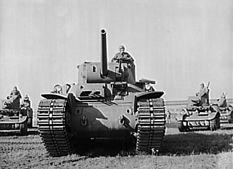 M6 heavy tank - Front view of M6, with several early M3 light tanks in the background.