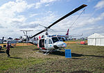 Heli-Serv (VH-JJR) Bell 212 Twin Huey on display at the 2015 Australian International Airshow 2.jpg