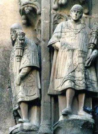 Cronista Rey de Armas - Heralds on the facade of San Juan de los Reyes church, Toledo, Spain