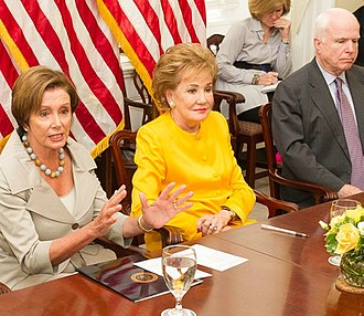 "Elizabeth Dole - Dole with Nancy Pelosi and John McCain at a 2014 meeting of the congressional ""Hidden Heroes Caucus"""