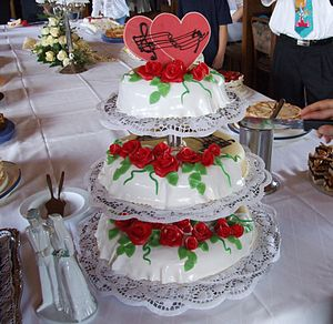 Wedding cake with hearts and roses on the buff...