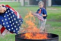 Honoring a symbol, Team Seymour holds flag retiring ceremony 140614-F-OB680-129.jpg