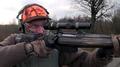 Hunter taking aim during a driven hunt Sweden 02.png