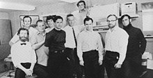 Ten computer engineers pose for a 1969 black-and-white photo