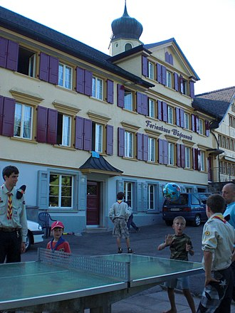 Schwende District - A group plays table tennis in front of buildings in Schwende