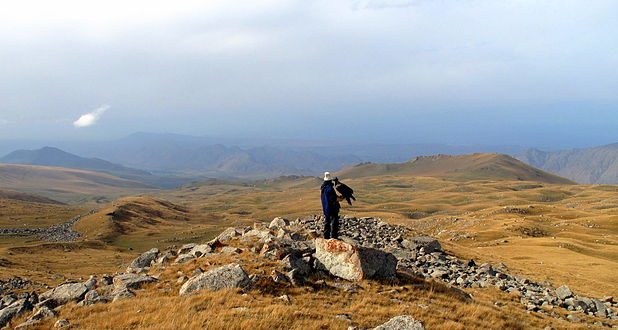 Ishenbek surveys the rolling expanse of the high steppe. (3968890120)