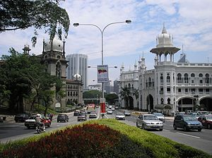 Arthur Benison Hubback - Kuala Lumpur Railway Station (right) and Malay Railway Administration Building (left), both by Hubback