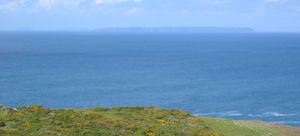 Channel Islands - Viewed from Jersey's north coast, Jethou, Herm and Sark are hazy outlines on the horizon.