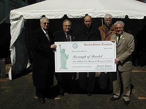 Rep.Greenwood presents a check for $2.1 millio...