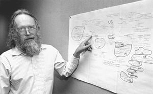 Jon Postel - Postel in 1994, with map of Internet top-level domains.