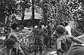 KNIL-militairen, deels met ontbloot bovenlijf bij een kampong, Bestanddeelnr 5402.jpg