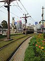 Kagoshima City Tram No. 101 and Railway near Kagoshima-Chuo Ekimae Station.jpg
